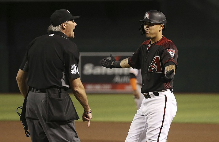 Arizona Diamondbacks' Ildemaro Vargas, right, argues with umpire Paul Nauert, left, after Vargas was called out at first base during the sixth inning against the San Francisco Giants on Saturday, June 22, 2019, in Phoenix. (Ross D. Franklin/AP)