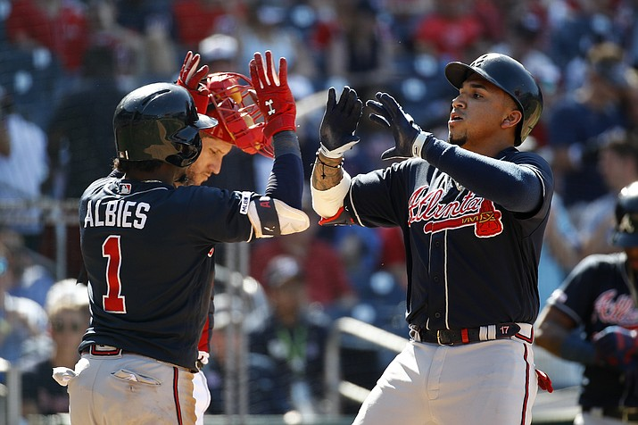 Atlanta Braves' Johan Camargo, right, and Ozzie Albies celebrate after Camargo batted Albies in on a two-run home run in the 10th inning of a game against the Washington Nationals, Sunday, June 23, 2019, in Washington. (Patrick Semansky/AP)