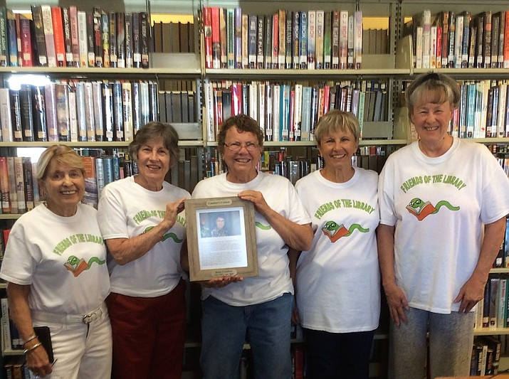 "Officers of the Friends of the Dewey-Humboldt Town Library gather to dedicate a special area of the library as ""Comfort's Corner"" in honor of the late Betty Comfort who was a long-time volunteer. From left are Sandra Goodwin, Margo Heikkila, Mary Franks, Skip Gladue and Signe Wray. (Friends of the D-H Library/Courtesy)"