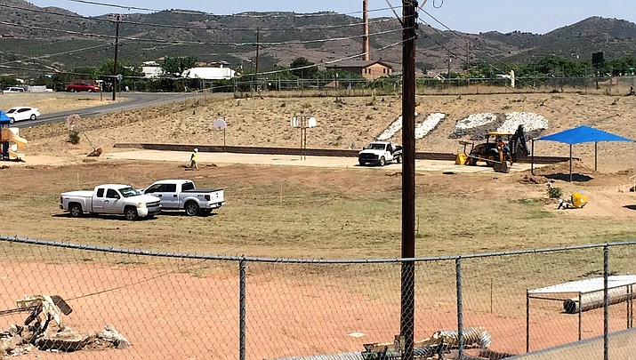 The playground at Humboldt Elementary School is undergoing improvements to its drainage, irrigation, ballfield and basketball courts. In the process, workers removed its trees and landscaping. (Sue Tone/Tribune)
