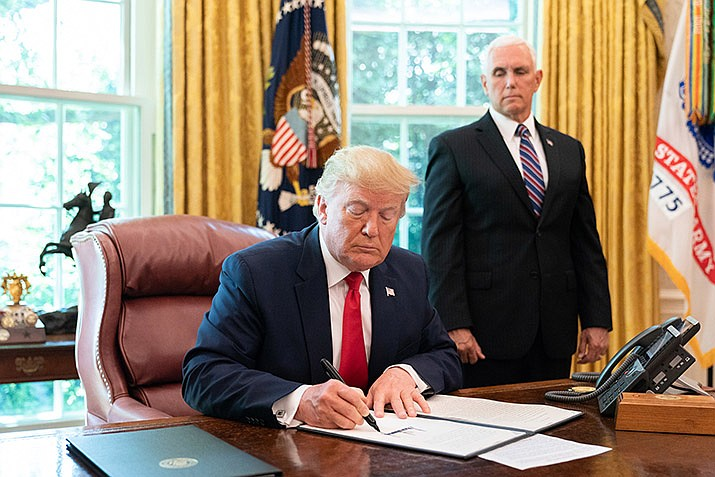 President Donald J. Trump signs an Executive Order to place further sanctions on Iran Monday, June 24, 2019, in the Oval Office of the White House. (Official White House Photo by Joyce N. Boghosian)