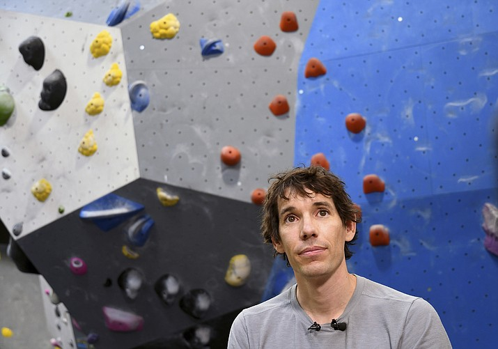 "In this June 18, 2019, photo, professional rock climber Alex Honnold is interviewed at the Earth Treks gym in Englewood, Colo. Honnold is trying to get a grip on life in the aftermath of the Academy Award winning documentary ""Free Solo."" His fear is that maybe his 2017 ropeless climb of El Capitan in Yosemite featured in the spine-tingling film just might be the summit of his career. (Thomas Peipert/AP)"