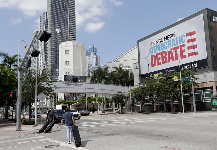 In this June 24, 2019, photo, a billboard advertises the Democratic Presidential Debates across from the Knight Concert Hall at the Adrienne Arsht Center for the Performing Arts of Miami-Dade County, in Miami. Don't envy NBC News executive Rashida Jones, who is behind this week's inaugural Democratic presidential debate and will have to juggle 20 candidates, five news personalities and, it's likely, one tweeting president.. (Lynne Sladky/AP)
