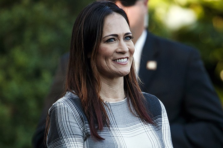 In this June 21, 2019, photo, Stephanie Grisham, spokeswoman for first lady Melania Trump, watches as President Donald Trump and the first lady greet attendees during the annual Congressional Picnic on the South Lawn in Washington. First lady Melania Trump has announced that Grisham will be the new White House press secretary. (Jacquelyn Martin/AP)