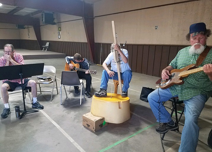 Musicians practice at the Williams Rodeo Barn in preparation for the July 6 Grand Opry Night fundraiser for Habitat for Humanity. (Kerry-Lynn Moede/photo)