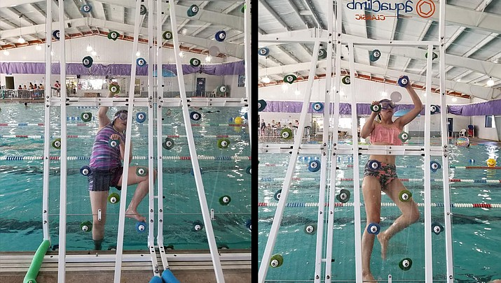 On belay: Swimmers enjoy new rock wall