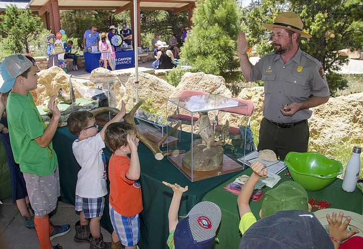Junior rangers are sworn in at Grand Canyon National Park for Junior Ranger Day June 22. (Bryan Maul/NPS)