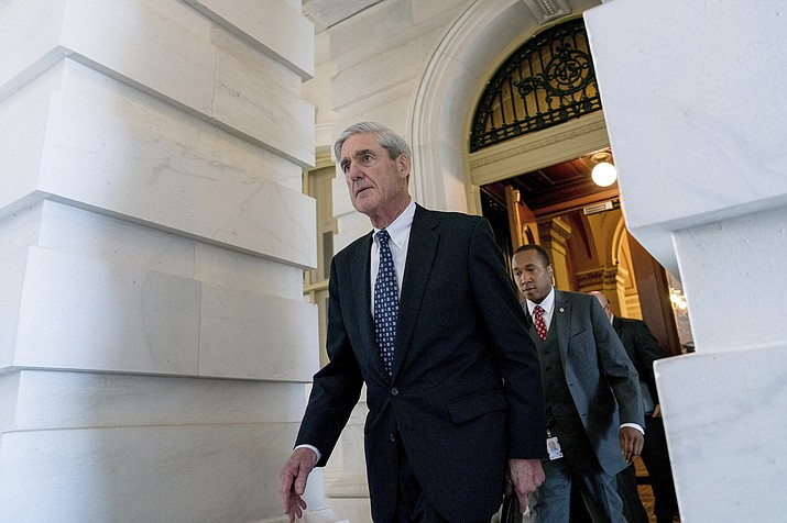 In this June 21, 2017, file photo, Special Counsel Robert Mueller departs Capitol Hill following a closed-door meeting in Washington. The debate over special counsel Robert Mueller's report is getting new life with word that Mueller has agreed to testify publicly before two House committees. Democrats say Mueller will appear July 17 in back-to-back sessions of the Judiciary and Intelligence committees. (Andrew Harnik/AP, File)