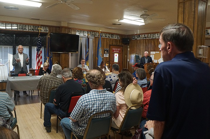 Prescott City Council candidate Steve Sischka, left, responds to a question from audience member Dwight Peter, standing far right, during a Monday, June 24, candidate forum at the Prescott American Legion Post 6, while other candidates, from left, Billie Orr, Jim Lamerson, and Cathey Rusing, and moderator Harry Oberg look on. (Cindy Barks/Courier)