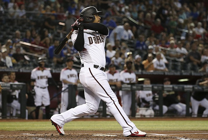 Arizona Diamondbacks' Eduardo Escobar watches the flight of his three-run home run against the Los Angeles Dodgers during the first inning of a game Wednesday, June 26, 2019, in Phoenix. (Ross D. Franklin/AP)