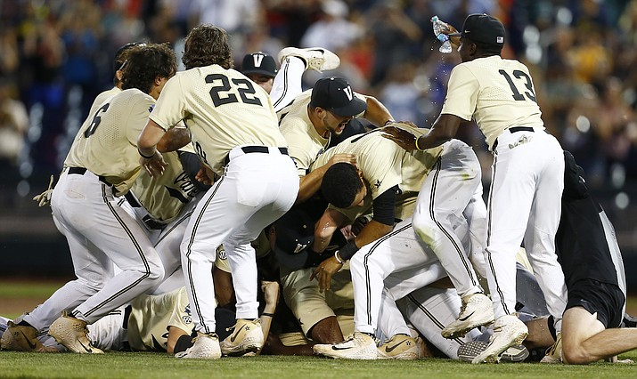 Vanderbilt players celebrate after defeating Michigan in Game 3 of the NCAA College World Series finals in Omaha, Neb., Wednesday, June 26, 2019. (John Peterson/AP)