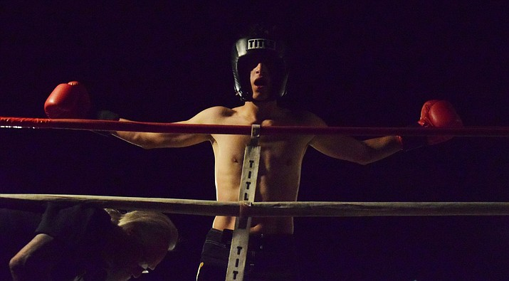 Alex Garza, from 2-Knuckles Sport in Surprise celebrates after winning the IKF junior amateur international rules Arizona State super welterweight title on Friday night at Reese's Tire Pros in Cottonwood. VVN/James Kelley