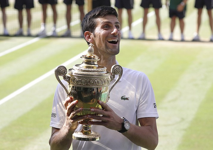Cutline: Serbia's Novak Djokovic holds the trophy after winning the men's singles final against Kevin Anderson of South Africa, on July 15, 2018, at the Wimbledon Championships, in London. As the start of play at the All England Club approaches, nothing captures the completely disparate states of men's and women's tennis at the moment than these two recent trends: The Big 3 of Roger Federer, Rafael Nadal and Djokovic have combined to win the past 10 Grand Slam tournaments, while nine women have collected major trophies in that span, including a half-dozen first-time champions. (Kirsty Wigglesworth/AP, File)