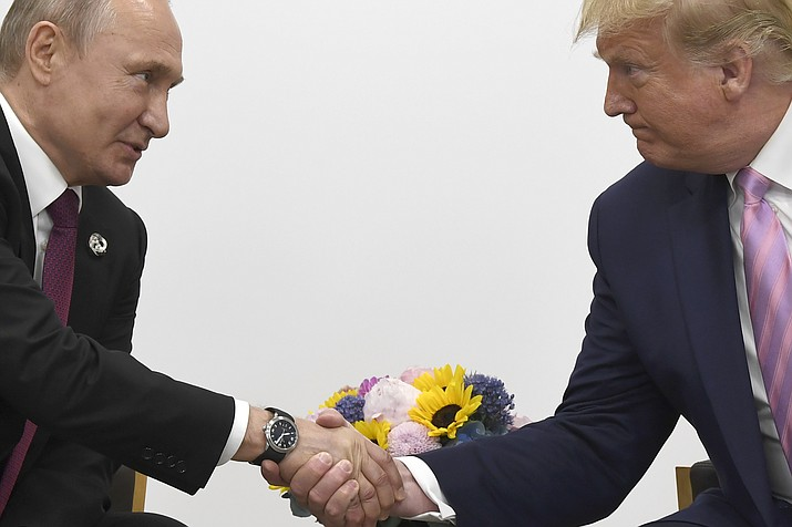 President Donald Trump, right, shakes hands with Russian President Vladimir Putin during a bilateral meeting on the sidelines of the G-20 summit in Osaka, Japan, Friday, June 28, 2019. (Susan Walsh/AP)