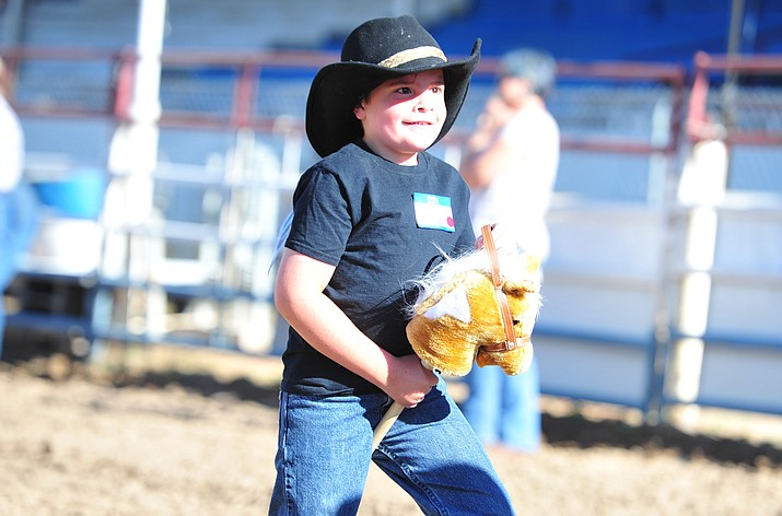 Jackson Hull is all smiles in his stick horse barrel race during the Happy Hearts Rodeo for exceptional children before the opening performance of last year's Prescott Frontier Days Rodeo. This year's Happy Hearts event is scheduled for 5 p.m. Monday at the Prescott Rodeo Grounds(Les Stukenberg/Courier file)