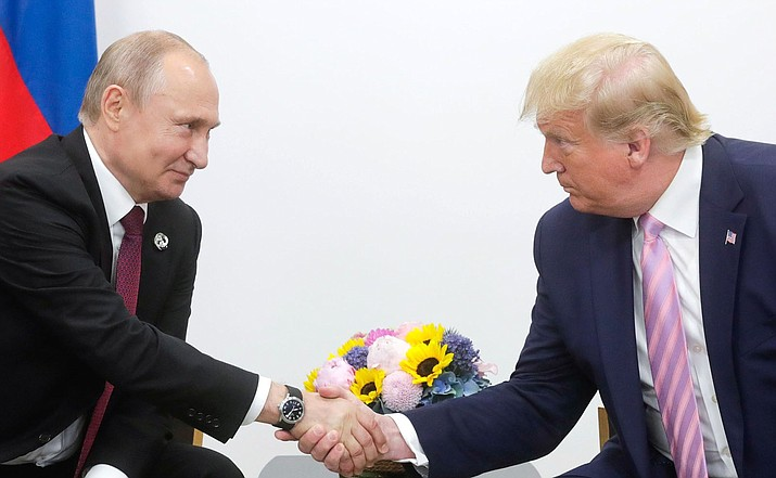 Vladimir Putin, left, and Donald Trump sat down with each other Friday for the first time in more than a year. (Photo courtesy of Presidential Press and Information Office, CC by 4.0, https://bit.ly/2FF2eRg)
