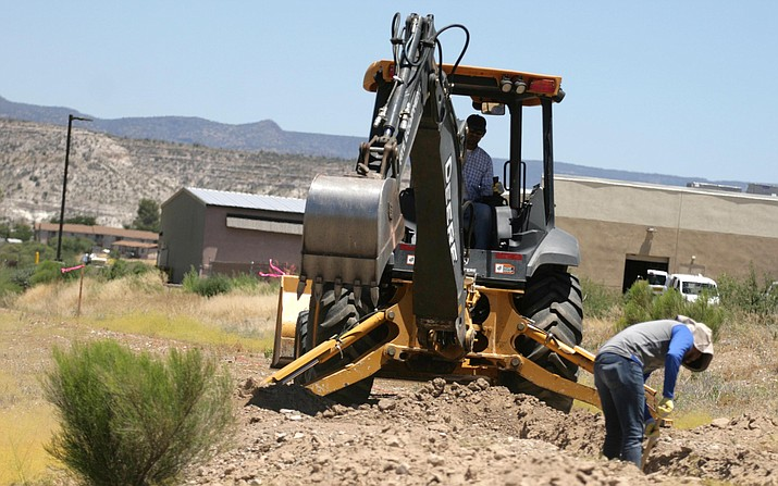 Wednesday, the CampVerde Town Council approved a final development plan and site plan for Phase 1A of the proposed Verde Ranch Estates gated community north of Finnie Flat Road and east of SR 260. Pictured, workers dig a hole Thursday along the property's south border. VVN/Bill Helm