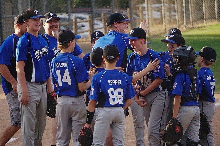 The Prescott All-Stars celebrate after getting the last out in their 11-0 win over Chino Valley during the District 10 Little League Major's Tournament championship game on Saturday, June 29, at Bill Vallely Field. (Aaron Valdez/Courier)