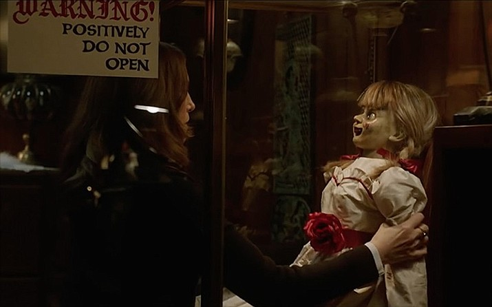 While babysitting the daughter of Ed and Lorraine Warren, a teenager and her friend unknowingly awaken an evil spirit trapped in a doll. (Warner Bros. Pictures)