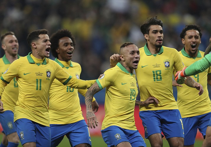 Brazil's players celebrate after winning the penalty shoot-out against Paraguay during a Copa America quarterfinal soccer match at the Arena do Gremio in Porto Alegre, Brazil, Thursday, June 27, 2019. (Natacha Pisarenko/AP)