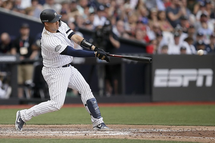 New York Yankees' Gary Sanchez hits a two-RBI single against the Boston Red Sox during the seventh inning of a baseball game in London, Sunday, June 30, 2019. (Tim Ireland/AP)