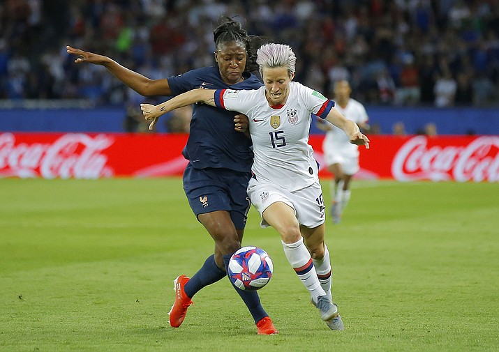 United States' Megan Rapinoe, right, is challenged by France's Kadidiatou Diani during the Women's World Cup quarterfinal between France and the United States at the Parc des Princes, in Paris on Friday, June 28, 2019. (Michel Euler/AP)
