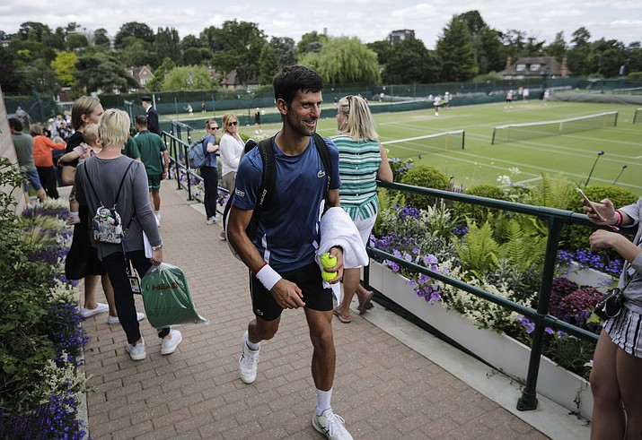 Serbia's Novak Djokovic leaves after playing a practice session ahead of the Wimbledon Tennis Championships in London Sunday, June 30, 2019. (Ben Curtis/AP)