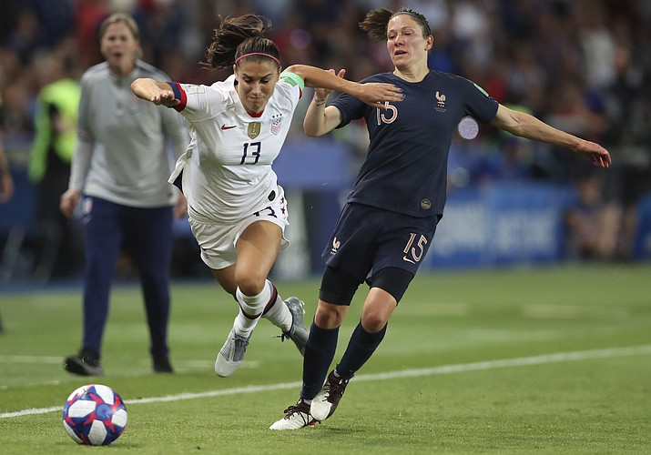 United States' Alex Morgan, left, competes for the ball against France's Elise Bussaglia during the Women's World Cup quarterfinal soccer match between France and the United States at the Parc des Princes, in Paris, Friday, June 28, 2019. (Francisco Seco/AP)