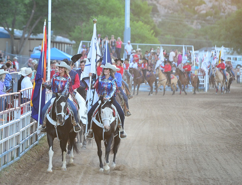 The Grand Entry kicks off the first performance of the Prescott Frontier Days Rodeo Monday July 1, 2019.  (Les Stukenberg/Courier)