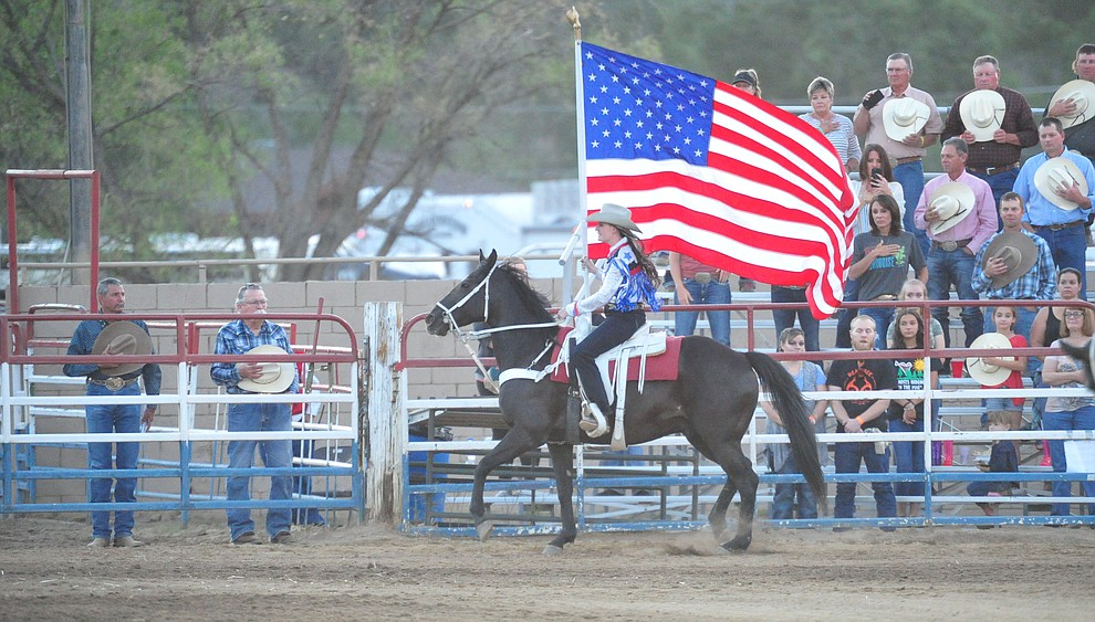 Presenting the American flag during the first performance of the Prescott Frontier Days Rodeo Monday July 1, 2019.  (Les Stukenberg/Courier)