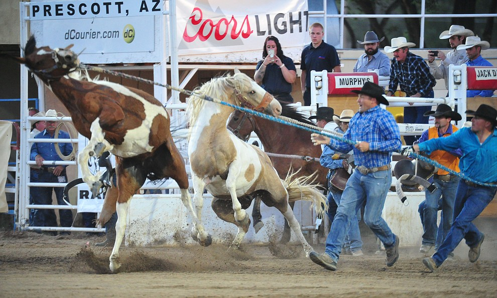 Wild Horse Race action during the first performance of the Prescott Frontier Days Rodeo Monday July 1, 2019.  (Les Stukenberg/Courier)