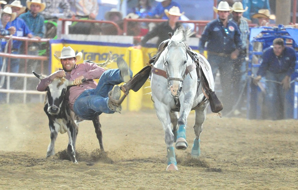 Blair Jones in the steer wrestling during the first performance of the Prescott Frontier Days Rodeo Monday July 1, 2019.  (Les Stukenberg/Courier)