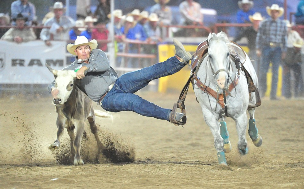 Dru Melvin in the steer wrestling during the first performance of the Prescott Frontier Days Rodeo Monday July 1, 2019.  (Les Stukenberg/Courier)