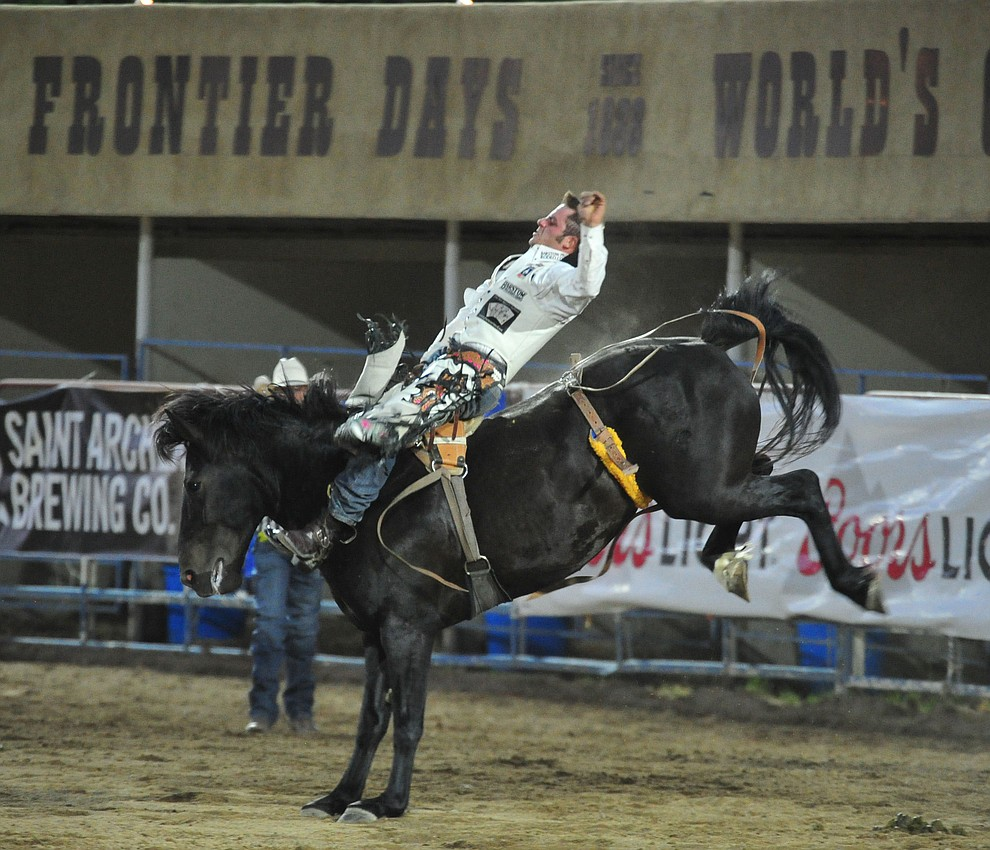 Austin Foss scores 81 on Excalibur in the bareback riding during the first performance of the Prescott Frontier Days Rodeo Monday July 1, 2019.  (Les Stukenberg/Courier)