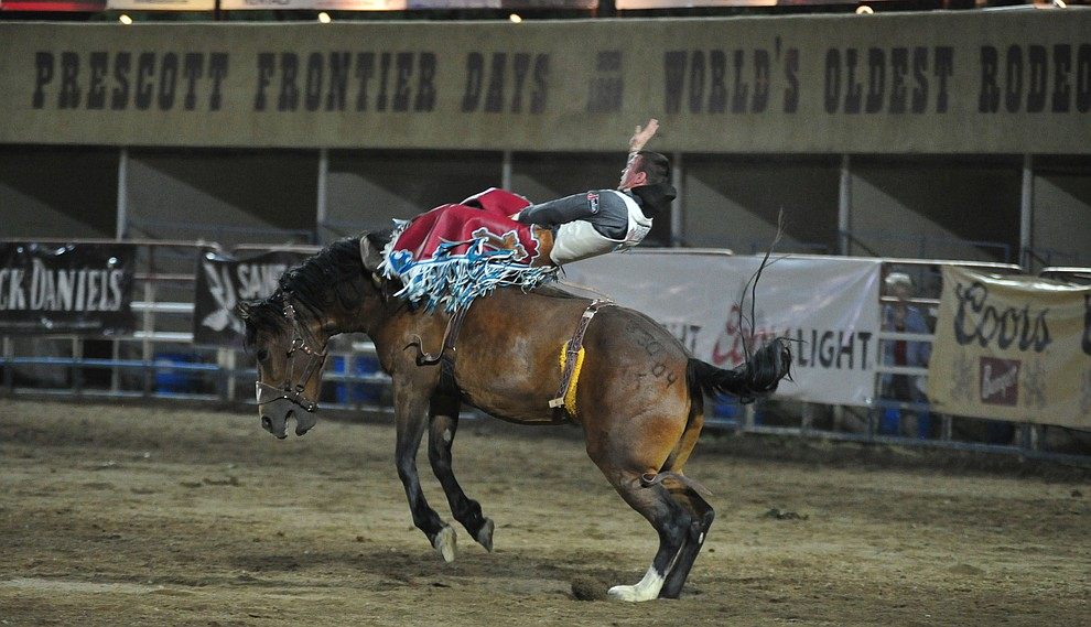 Tim O'Connell scores 86 on Sun Glow for the lead in the bareback riding during the first performance of the Prescott Frontier Days Rodeo Monday July 1, 2019.  (Les Stukenberg/Courier)