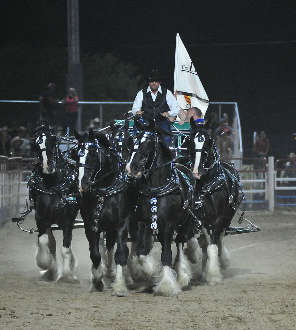The Diamond Z English Shire Horses thrill the capacity crowd during the first performance of the Prescott Frontier Days Rodeo Monday July 1, 2019.  (Les Stukenberg/Courier)