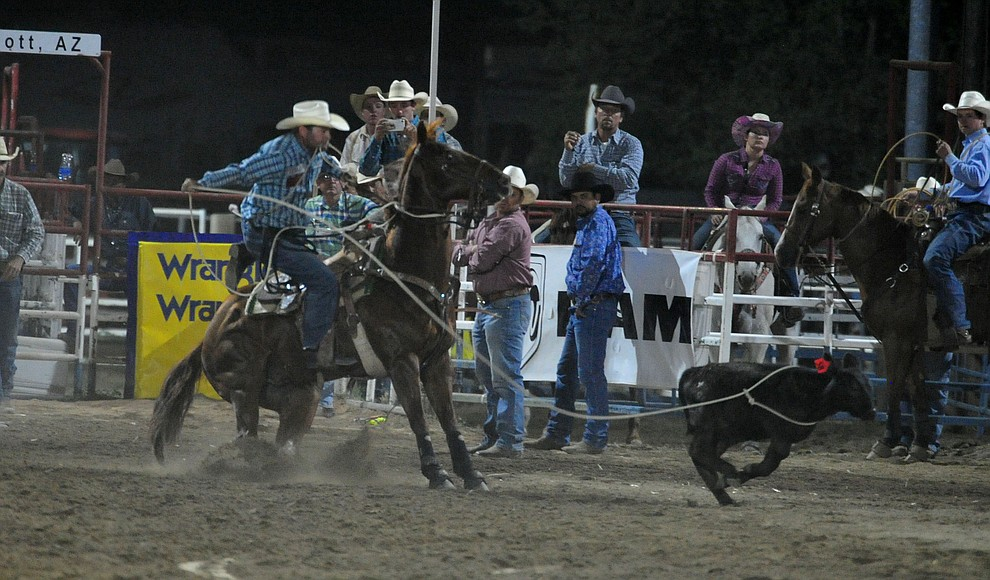 J.D. Kibbe has an 8.5 second run in the tie down roping for the lead during the first performance of the Prescott Frontier Days Rodeo Monday July 1, 2019.  (Les Stukenberg/Courier)