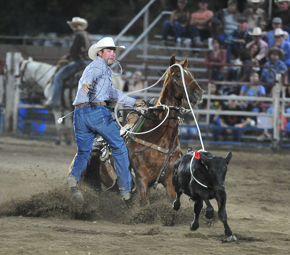 Jesse Clark in the tie down roping during the first performance of the Prescott Frontier Days Rodeo Monday July 1, 2019.  (Les Stukenberg/Courier)