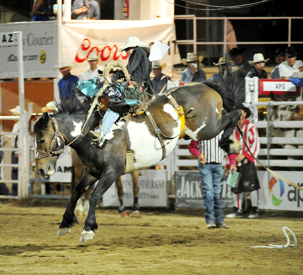Roper Kiesner scores 78 on Table Talk in the saddle bronc riding during the first performance of the Prescott Frontier Days Rodeo Monday July 1, 2019.  (Les Stukenberg/Courier)