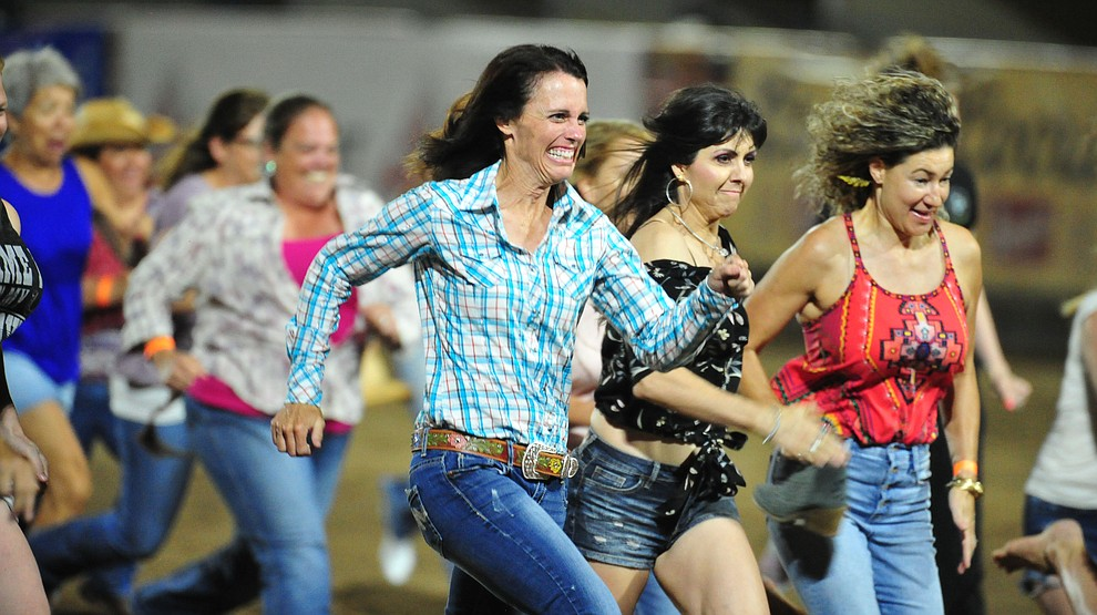 Ladies chased their boot for a chance at $250 during the first performance of the Prescott Frontier Days Rodeo Monday July 1, 2019.  (Les Stukenberg/Courier)