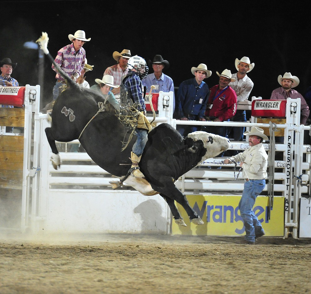 Riker Carter got a reride on Sugar Ray and scored an 82.5 to take the lead in the bull riding during the first performance of the Prescott Frontier Days Rodeo Monday July 1, 2019.  (Les Stukenberg/Courier)