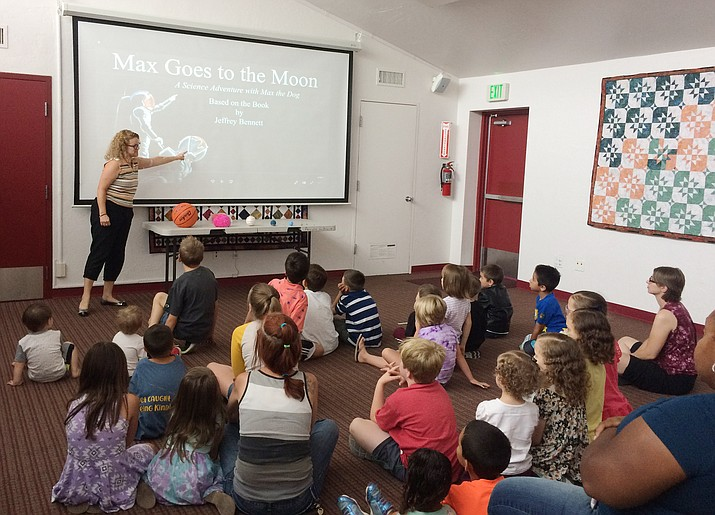 Stacy DeVeau, University of Arizona STEM Program coordinator, presents an astronomy program during the Summer Fun Kids Club at the Chino Valley Public Library on Wednesday, June 26, 2019. (Jason Wheeler/Review)
