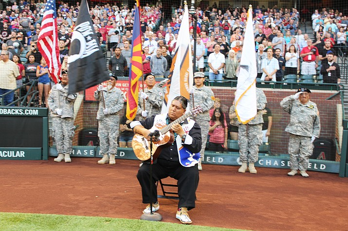 Native American classical guitarist Gabe Ayala performs the national anthem with native veterans behind him at Chase Field in Phoenix June 1. (Stan Bindell/NHO)