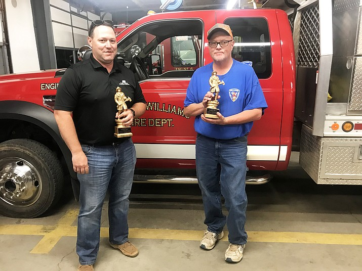 Williams Volunteer Firefighters Jeff Dent and Jeff Pettit were recognized June 5 for more than 15 years of service with the department. (Loretta Yerian/WGCN)