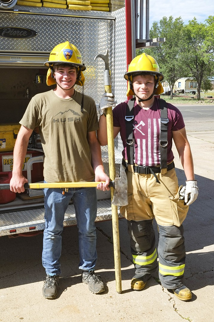 Williams Volunteer Fire Department welcomes its newest recruits, high school students Caleb Burlington and James Eischen. (Loretta Yerian/WGCN)
