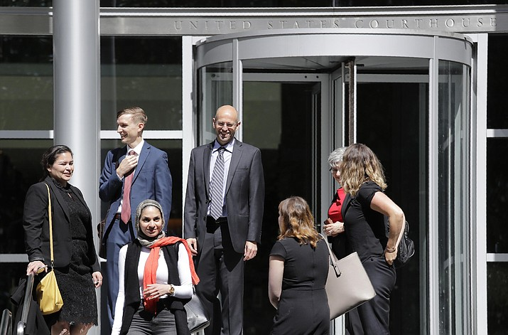 In this June 28, 2019, file photo, Matt Adams, center right, Legal Director of the Northwest Immigrant Rights Project, leaves the U.S. Courthouse with others after a hearing on asylum seekers in Seattle. On Tuesday, July 2, 2019, a federal judge in Seattle has blocked a Trump administration policy that would keep thousands of asylum seekers locked up while they pursue their cases. (Elaine Thompson/AP, file)