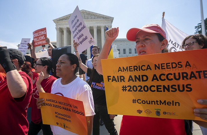 In this June 27, 2019, file photo, Demonstrators gather at the Supreme Court as the justices finish the term with key decisions on gerrymandering and a census case involving an attempt by the Trump administration to ask everyone about their citizenship status in the 2020 census, on Capitol Hill in Washington. The Justice Department said Tuesday that the 2020 Census is moving ahead without a question about citizenship. (J. Scott Applewhite/AP, file)