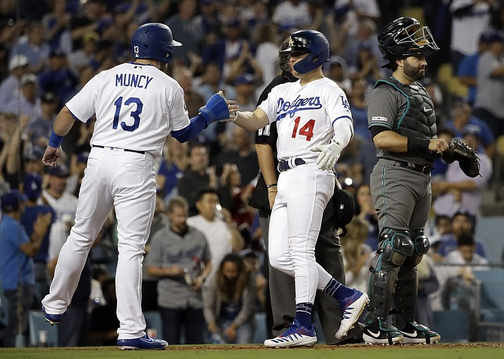 Los Angeles Dodgers' Enrique Hernandez (14) celebrates his two-run home run with Max Muncy (13) during the fourth inning of the team's baseball game against the Arizona Diamondbacks on Tuesday, July 2, 2019, in Los Angeles. (Marcio Jose Sanchez/AP)