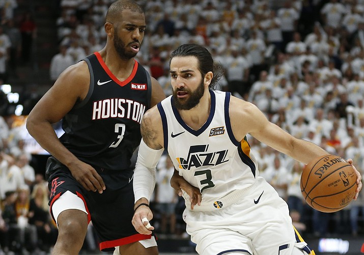 Utah Jazz guard Ricky Rubio (3) drives around Houston Rockets guard Chris Paul (3) in the second half during Game 4 of a first-round NBA playoff series Monday, April 22, 2019, in Salt Lake City. The Phoenix Suns and Rubio, who entered free agency this summer, agreed to a three-year, $51 million deal on Sunday, June 30. (Rick Bowmer/AP)