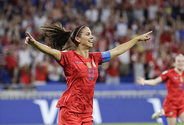 United States' Alex Morgan celebrates after scoring her side's second goal during the Women's World Cup semifinal soccer match between England and the United States, at the Stade de Lyon, outside Lyon, France, Tuesday, July 2, 2019. (Alessandra Tarantino/AP)